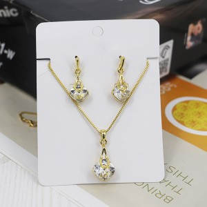 Gold Plated Crystal Carved Party Wear Jewellery Set - Golden