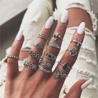 Fourteen Piece Multi Shaped Fine Carved Vintage Rings Set