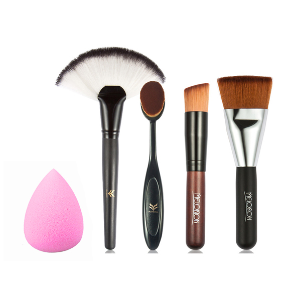 Set Of Four Makeup Brushes With Pink Puff