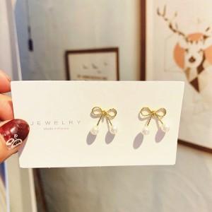 Ladies Elegant Pearl Bow Earrings - Golden