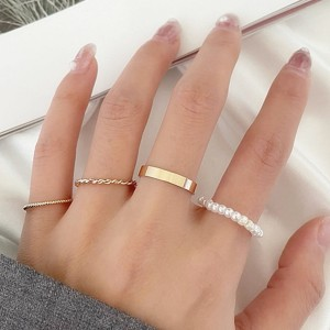 Gold Plated Pearl Patched Four Pieces Rings Set